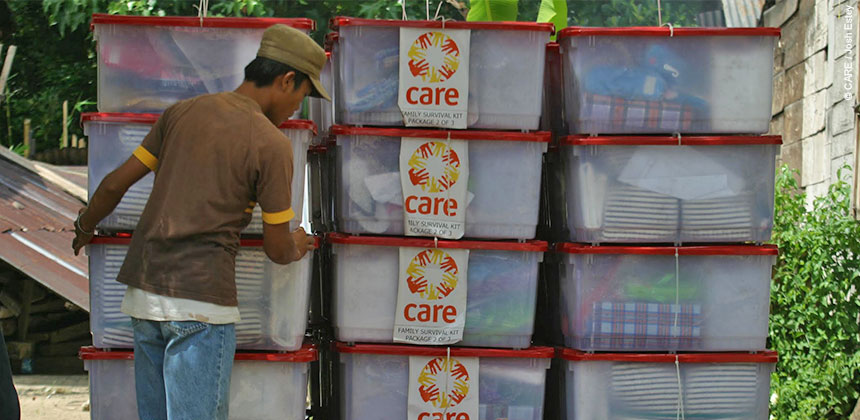 Aid worker prepares family survival kits for distribution