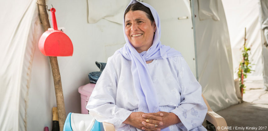 Fatima inside her tent home at Chamisku camp