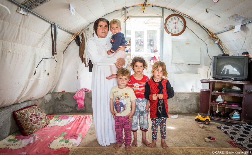 A woman and her children inside a tent at Chamisku camp, Iraq