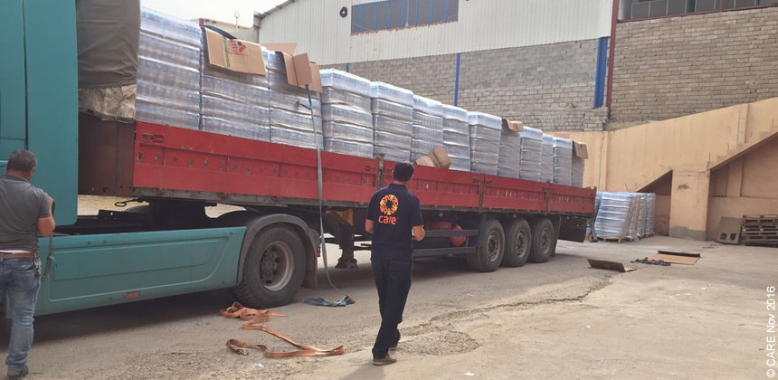 Lorry delivering supplies to warehouse in Iraq