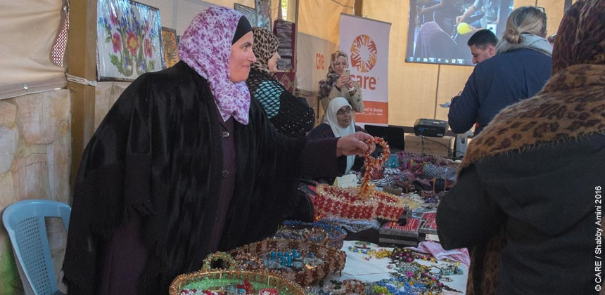 Women selling jewellery at a market in Azraq camp