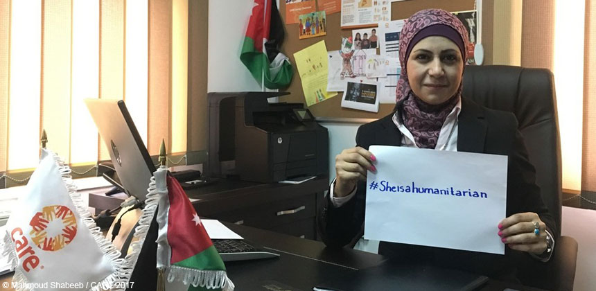Eman Ismail holding 'She is a humanitarian' sign