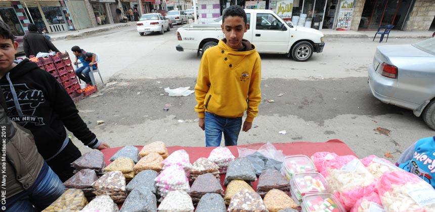 Young man selling snacks from a street stall