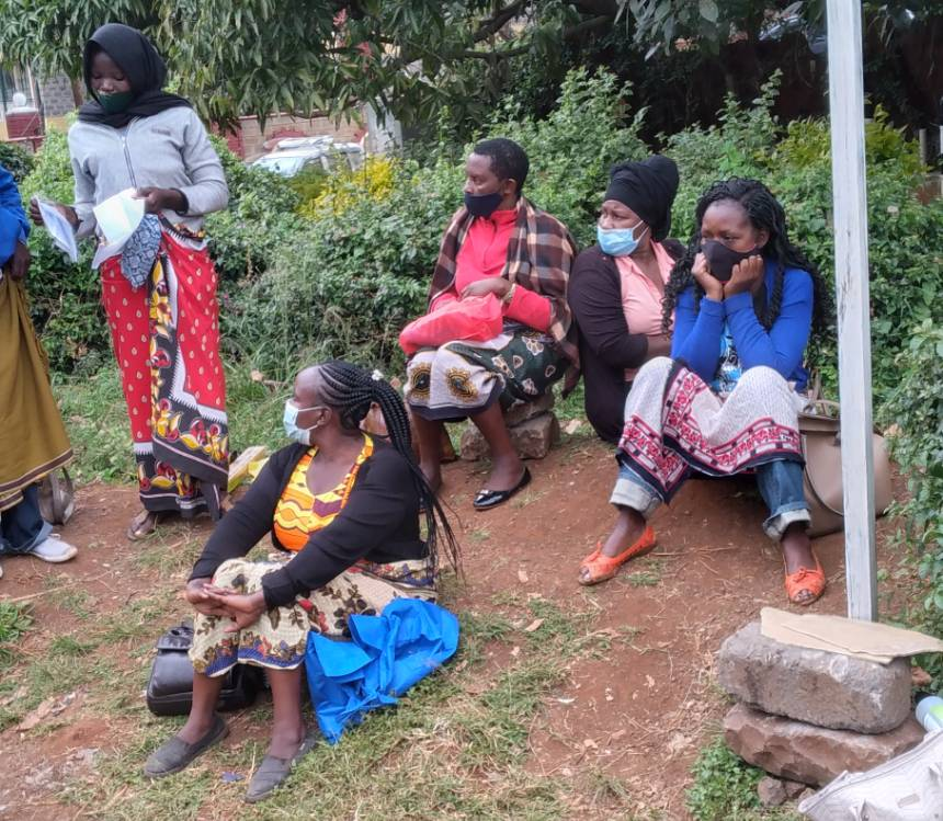 Domestic workers waiting on streetside for work