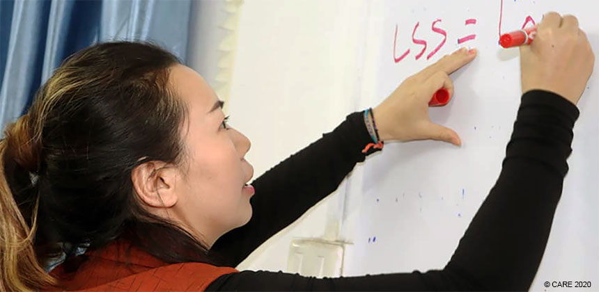 Bouavanh Manichanh writing on a whiteboard