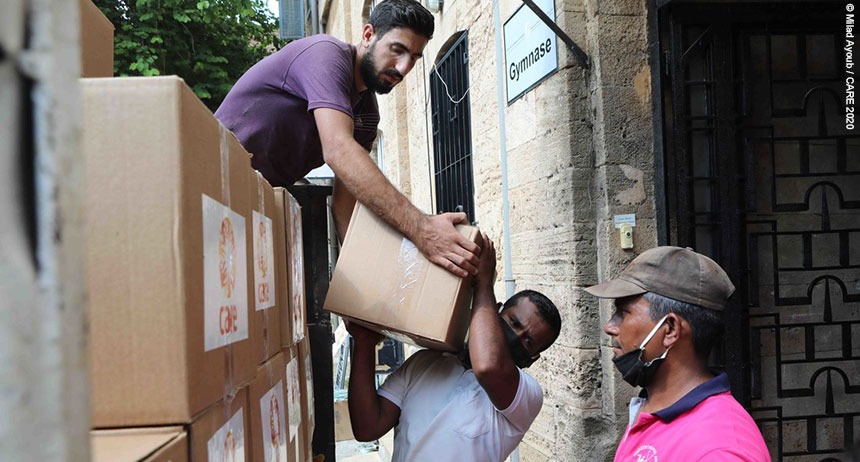 Men unloading CARE package boxes from lorry in Beirut