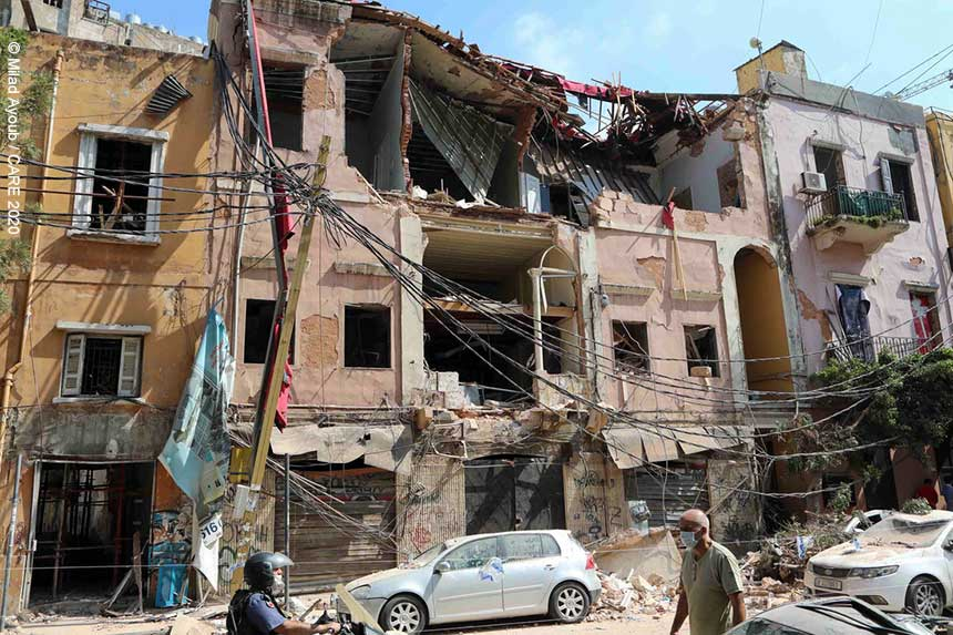 Damaged buildings and cars in Beirut