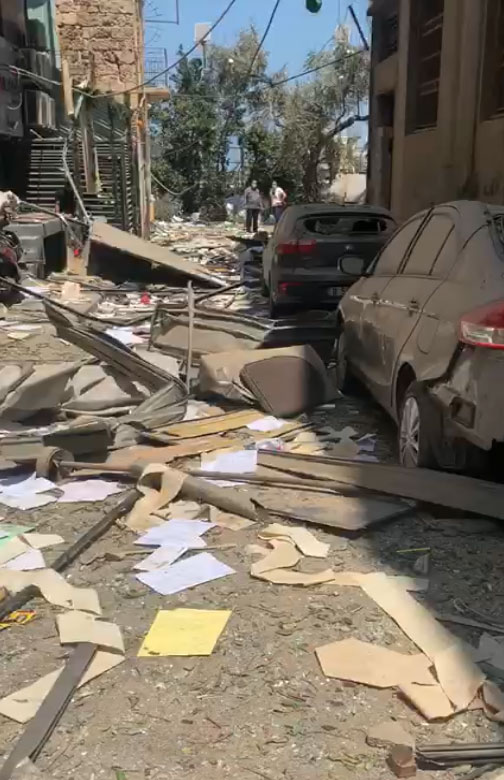 Debris and damage to buildings and cars in Beirut