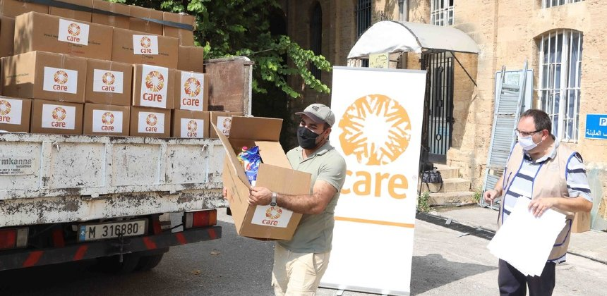CARE workers carrying aid boxes from lorry in Beirut