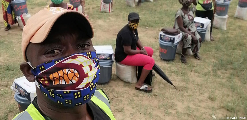 Emmanuel in face mask at CARE distribution in Liberia
