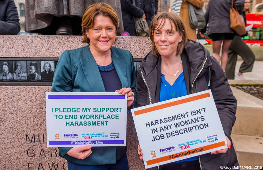 Maria Miller and Jess Phillips holding placards
