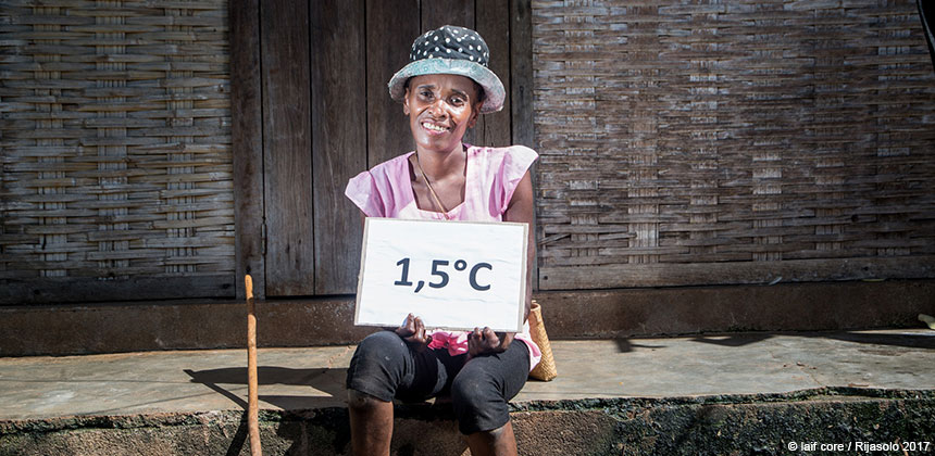 Josiane Ramaroson, in Madagascar, holding a 1.5 degrees sign
