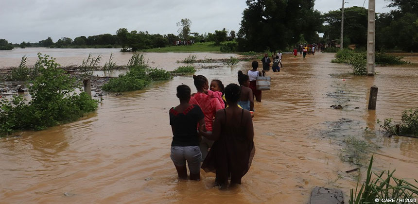 People wading through floodwaters in Madagascar
