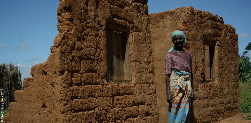 Esther outside her damaged house