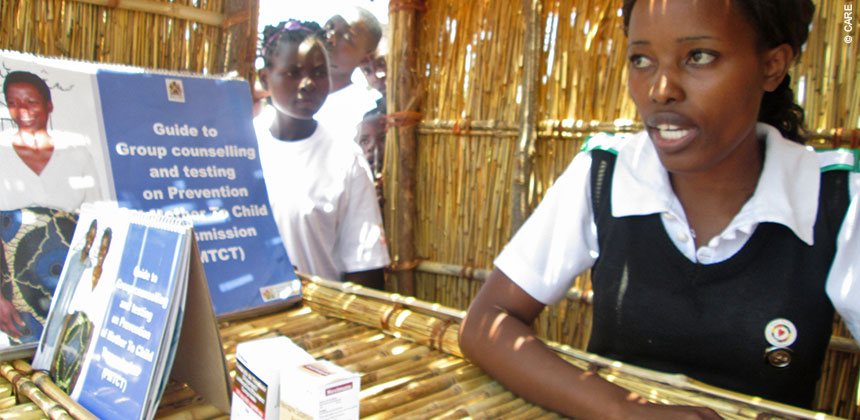 Nurse in Malawi displaying materials on how HIV is transmitted