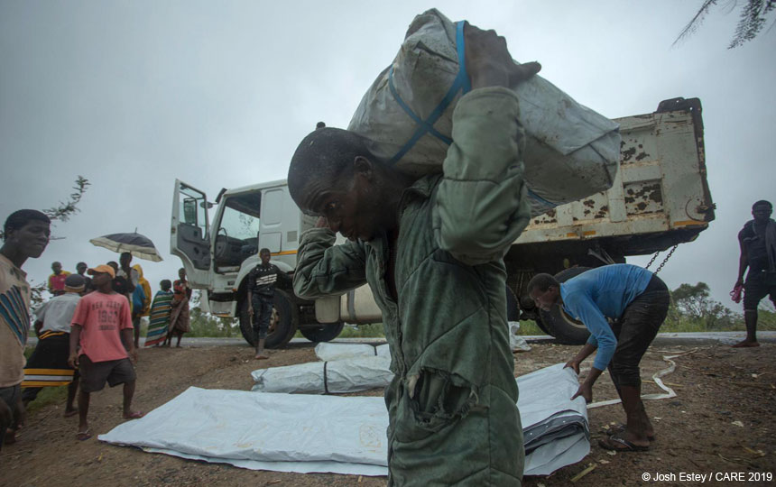Man carrying relief supplies, Mozambique