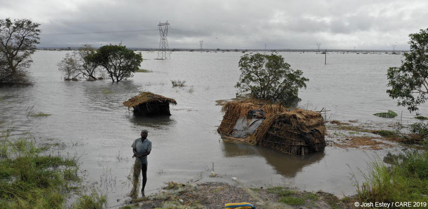 Man standing near submerged homes, Mozambique