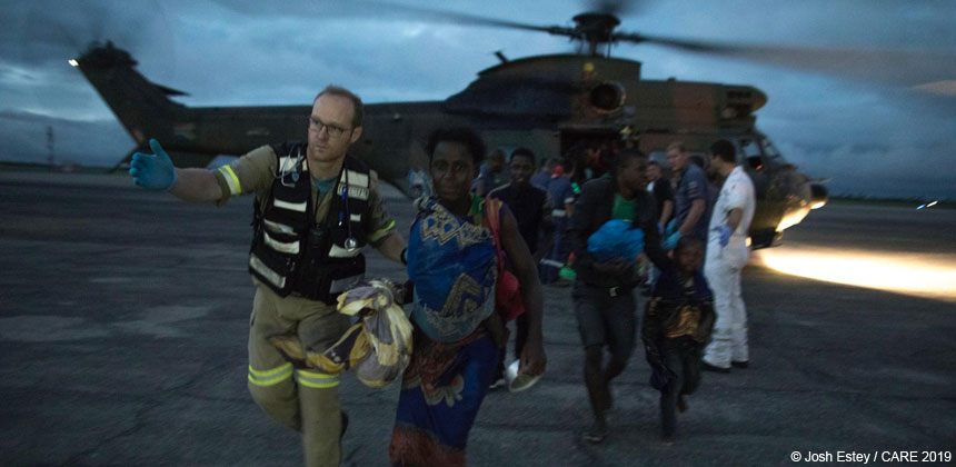 People disembarking from rescue helicopter, Mozambique