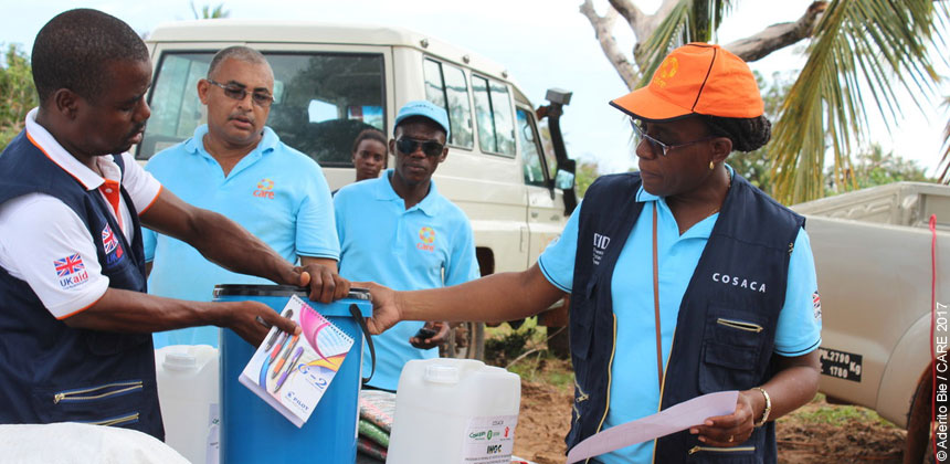 CARE staff distributing emergency kits in Mozambique