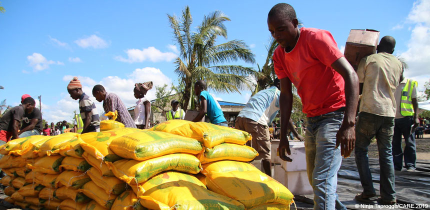 People with sacks of food at a CARE aid distribution in Mozambique