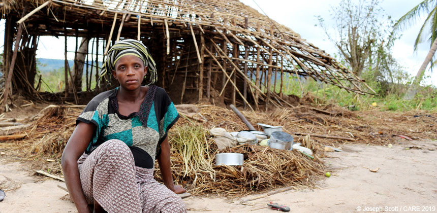 Nhamu outside her cyclone-damaged home
