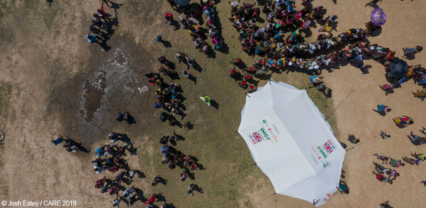 Aerial shot of tent with UK aid logo, Mozambique
