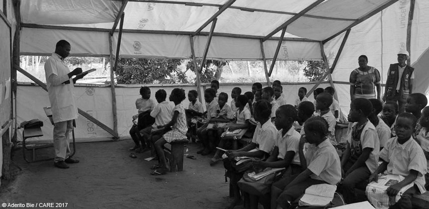 Children in a temporary classroom in Mozambique
