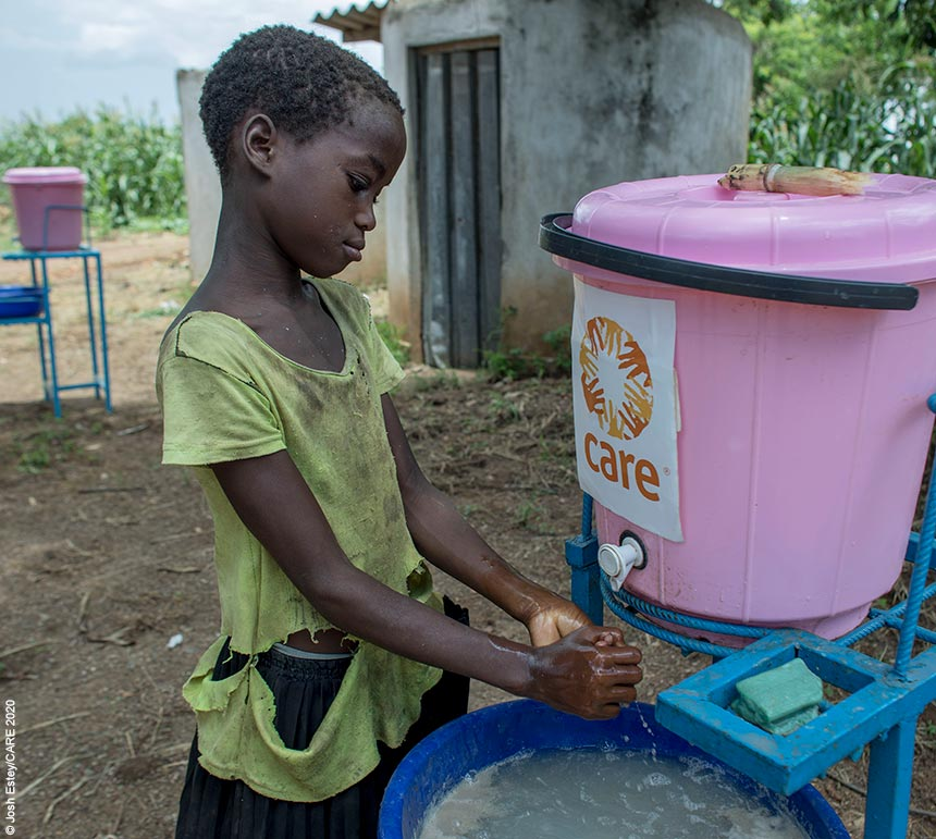Girl washing her hands at a school in Mozambique