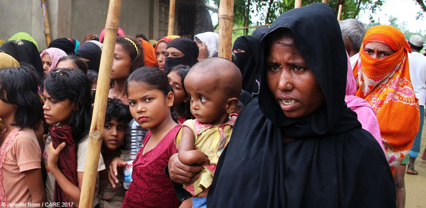 Women and children queuing for food at refugee camp in Bangladesh