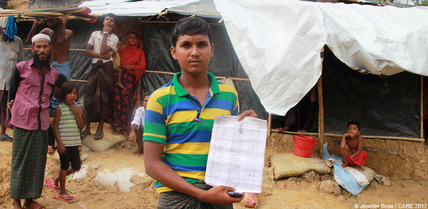 Young man holding paper at refugee camp in Bangladesh