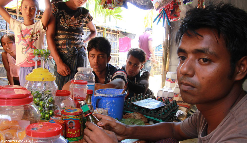 People at snack stall at refugee camp in Bangladesh