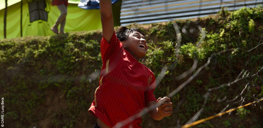 Boy playing volleyball in Mandre village, Nepal