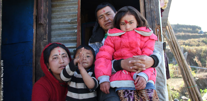 A family on the doorstep of their home in Nepal