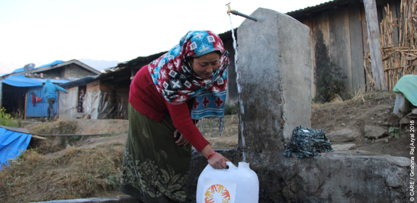 Sunita collecting water from a water point