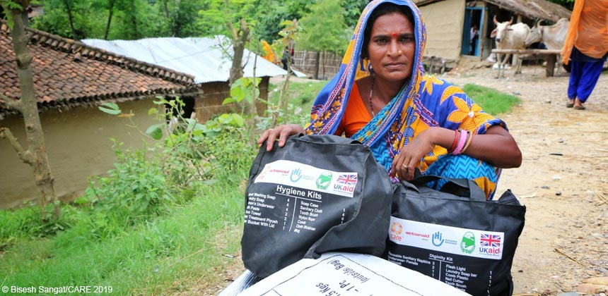 Woman in Nepal with hygiene kits distributed by CARE