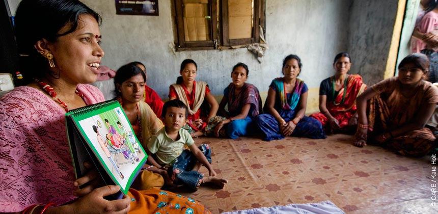 A health worker in Nepal meeting with young mothers