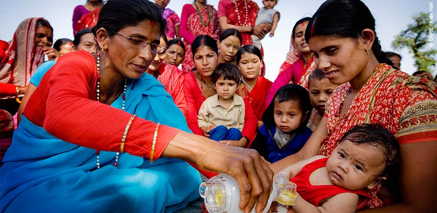 Community health worker Ganga Devi demonstrates hygiene techniques to women near Dhangadhi, Nepal