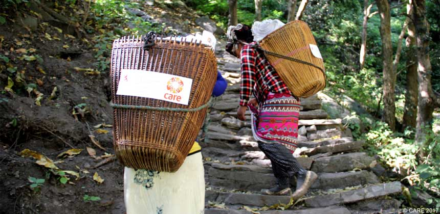Two women carrying supplies in Nepal