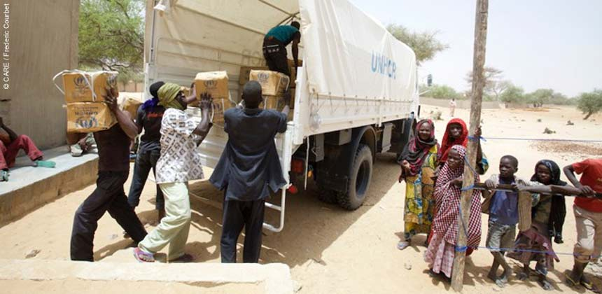Unloading relief supplies from a lorry