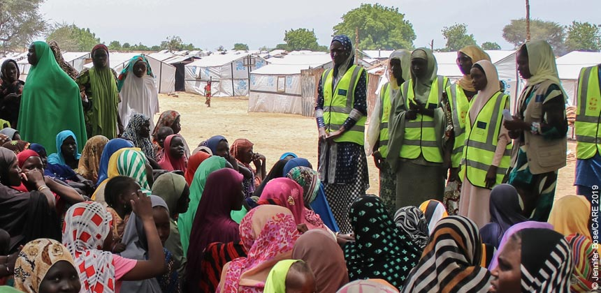 Women humanitarians speaking to women at camp in Nigeria