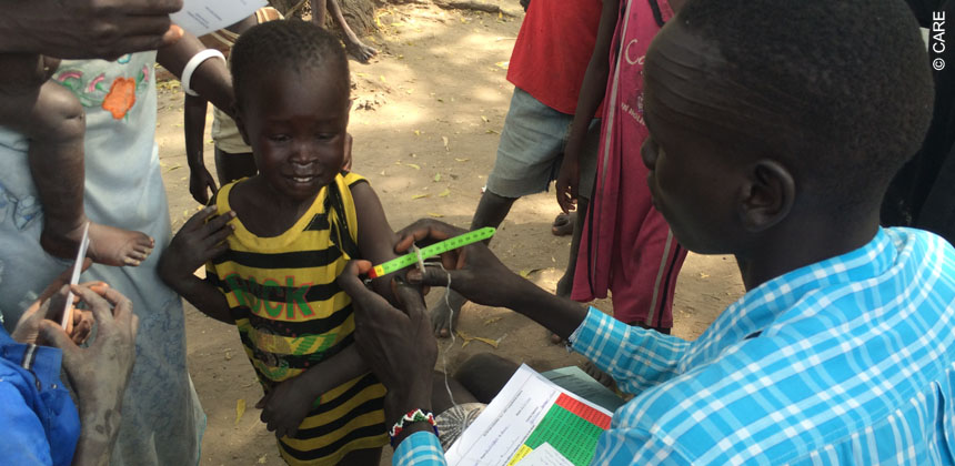 Health workers screen children for malnutrition
