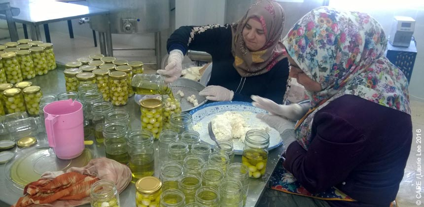 Women packing cheese at a factory in the OPT