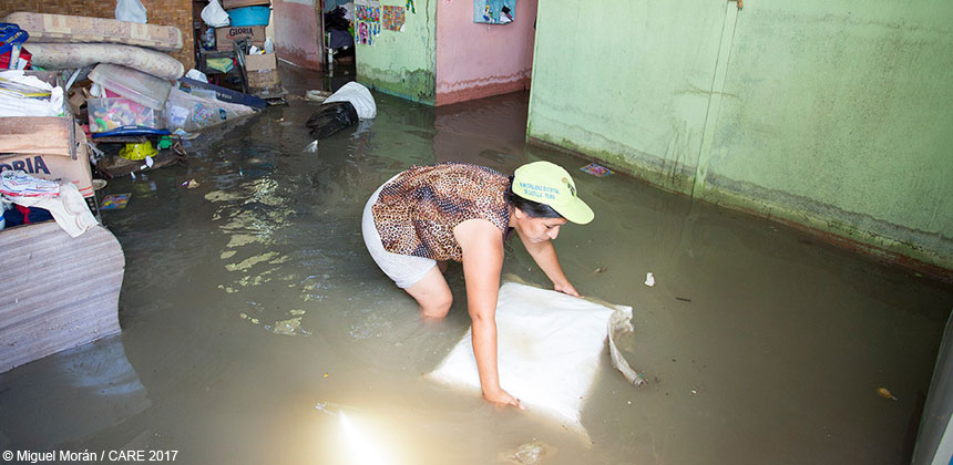 A woman in a flooded house in Peru