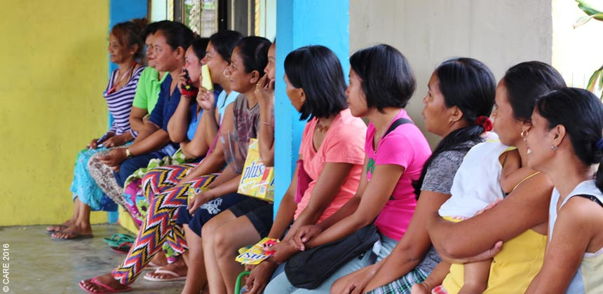 Women attending a community meeting