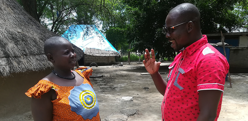 CARE worker Richard James-Koma speaking to a woman