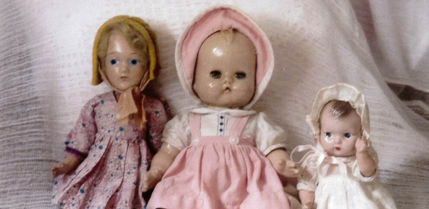 Three dolls from a CARE package