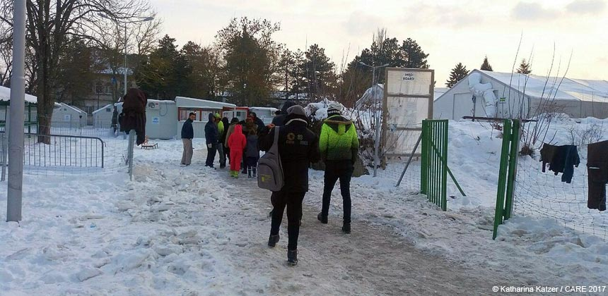 People entering a compound in snowy Belgrade