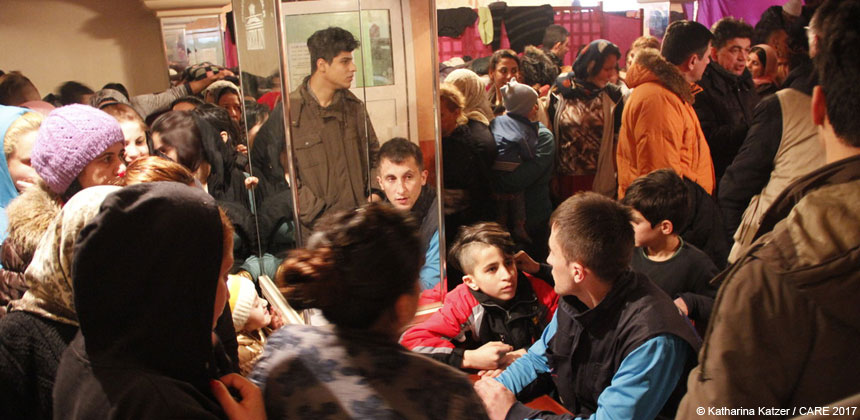 People gathering in a room in a refugee camp