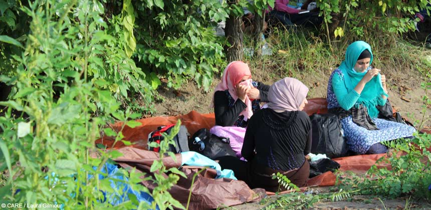 Syrian refugees resting by roadside