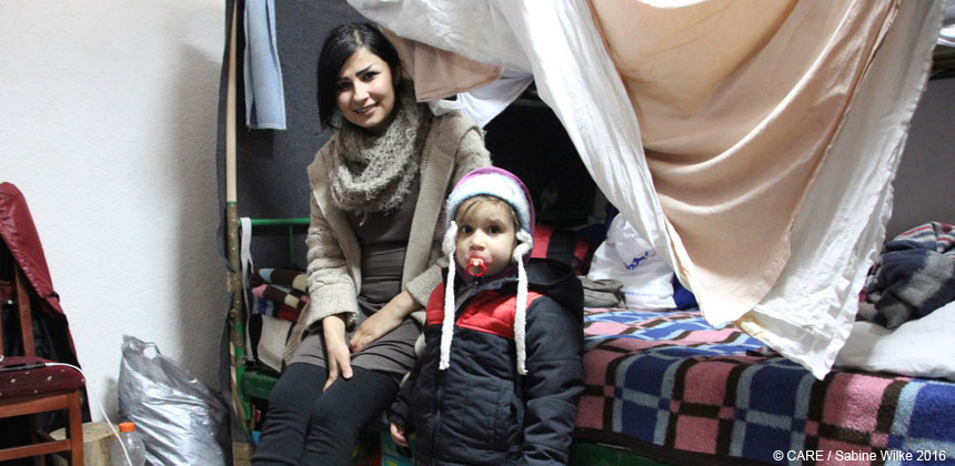 A woman and child on a bunk bed